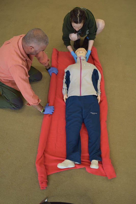 learn to manage a suspected spinal injury with shock.