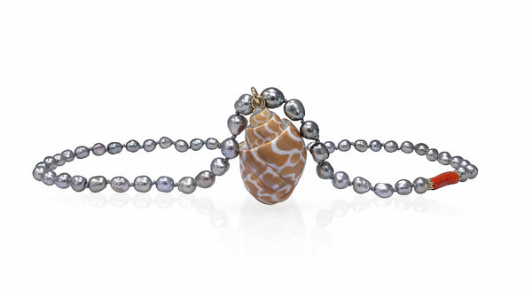Tahitian Keshi pearl Necklace with Coral and Cone Shell