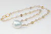 rutilated quartz beads and a giant cloud pearl necklace