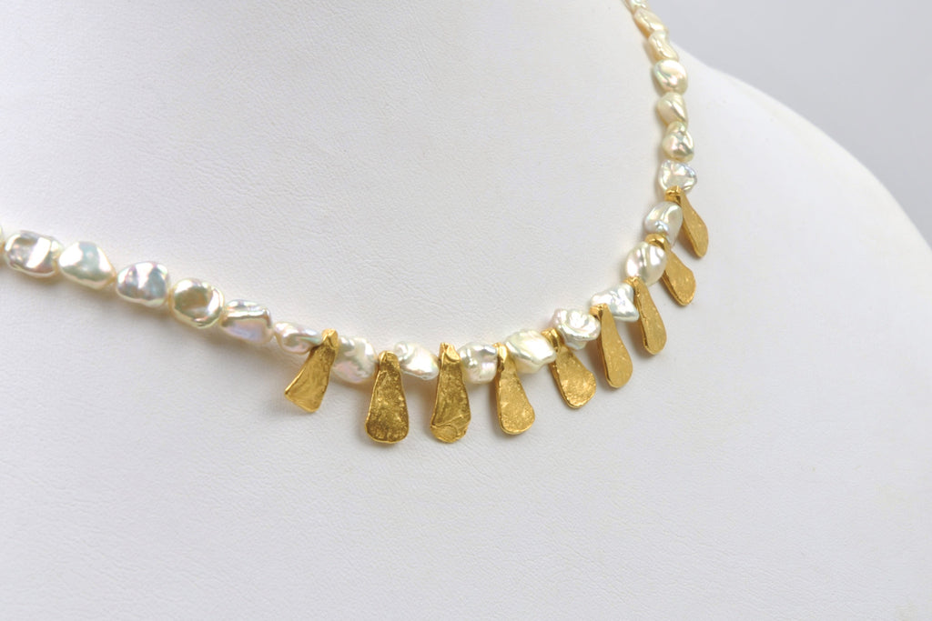 tiny metallic luster keshi pearls and gold petal necklace