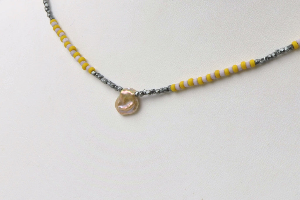 beaded choker with tiny petal pearl necklace