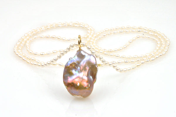 gigantic flame pearl on white pearl rope