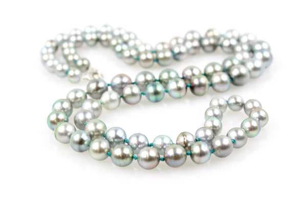 rope of silver Tahitian pearls on aqua knots