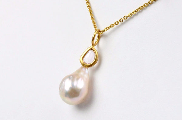 champagne japan kasumi pearl and sapphire pendant