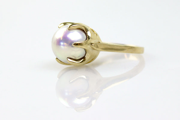 glowing fresh water pearl in yellow gold crown set ring
