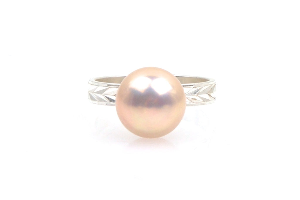 peach pearl and silver arrow ring