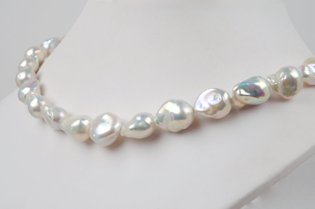 long strand of metallic white baroque drop pearls