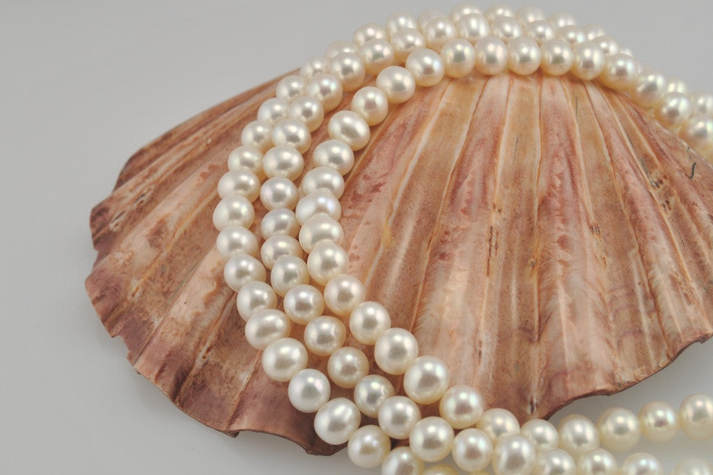 3 strands of white oval pearls