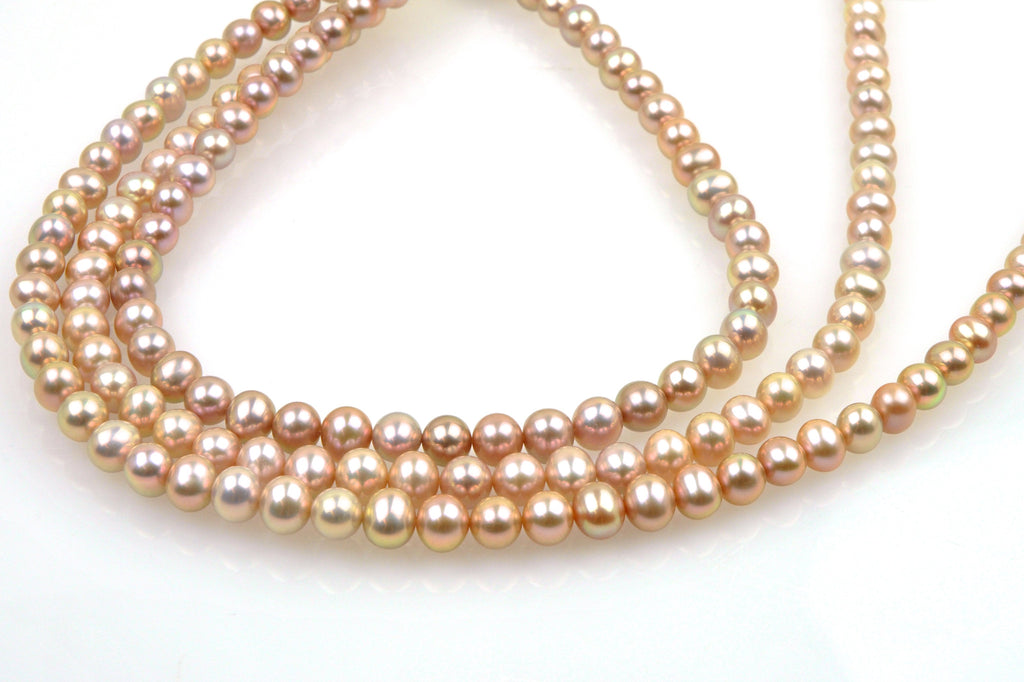 3 strand lot of oval apricot pearls