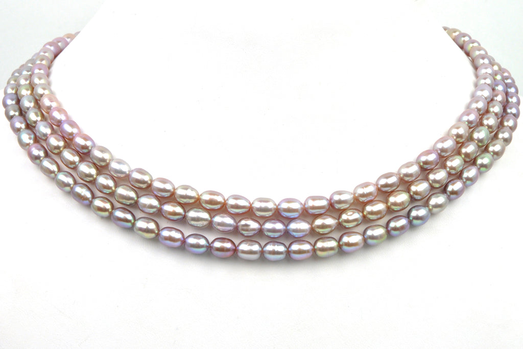 3 strand lot of iridescent mauve oval pearls