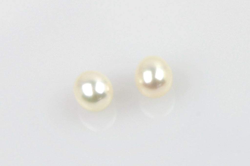 tiny white oval pearl pair