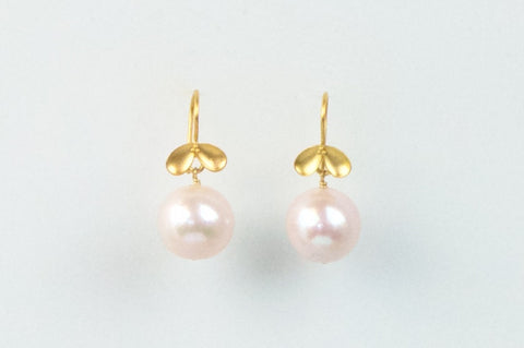 golden floral and pink pearl earrings