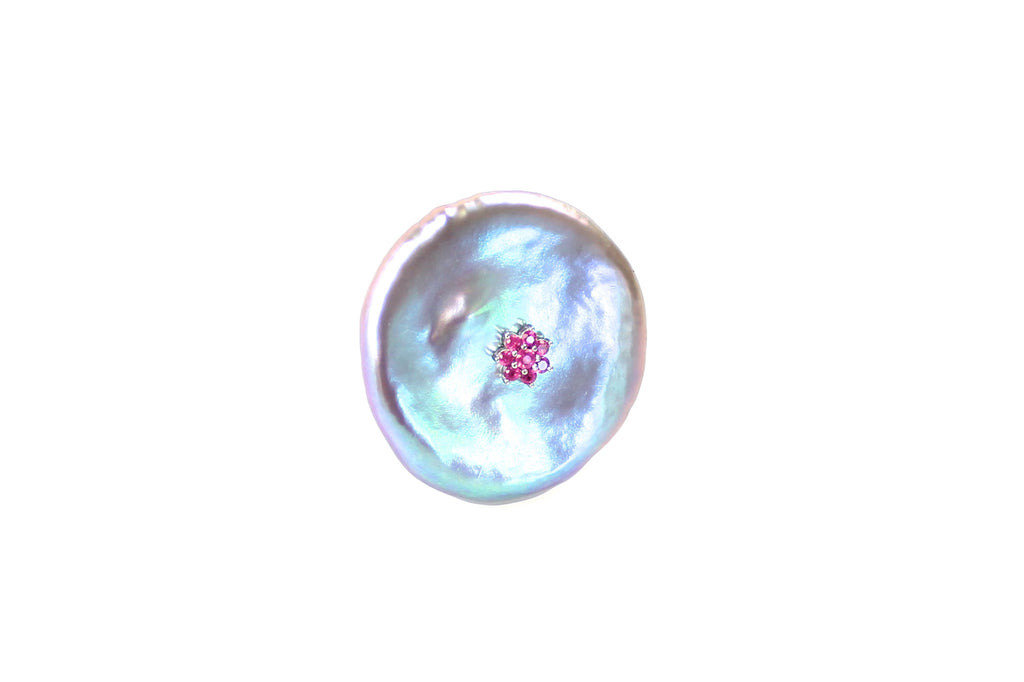 glowing pearl disc ring with ruby blossom