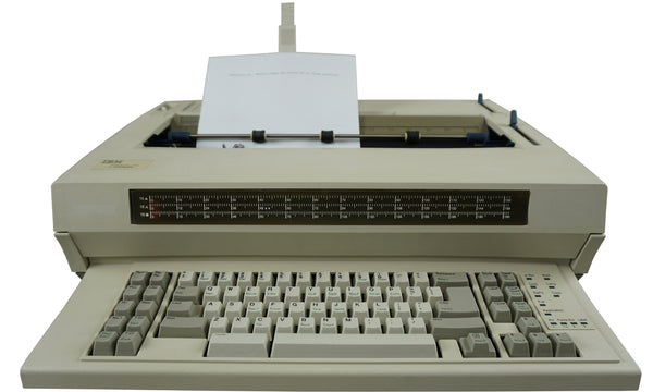 "IBM Lexmark Wheelwriter 1500 Typewriter Factory Certified ""New"" Front View with Paper Guide Lifted and Paper Loaded"