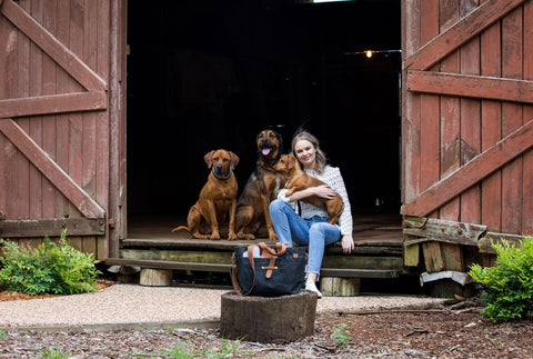 Kate, Ted and Harry with the Mutt-tote, an all-in-one 'nappy bag' for dogs