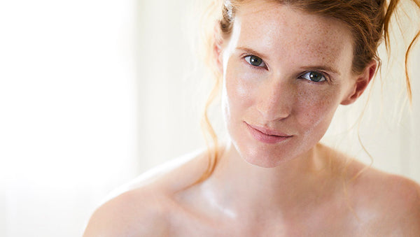 Model with dewy skin after Tri-Balm facial