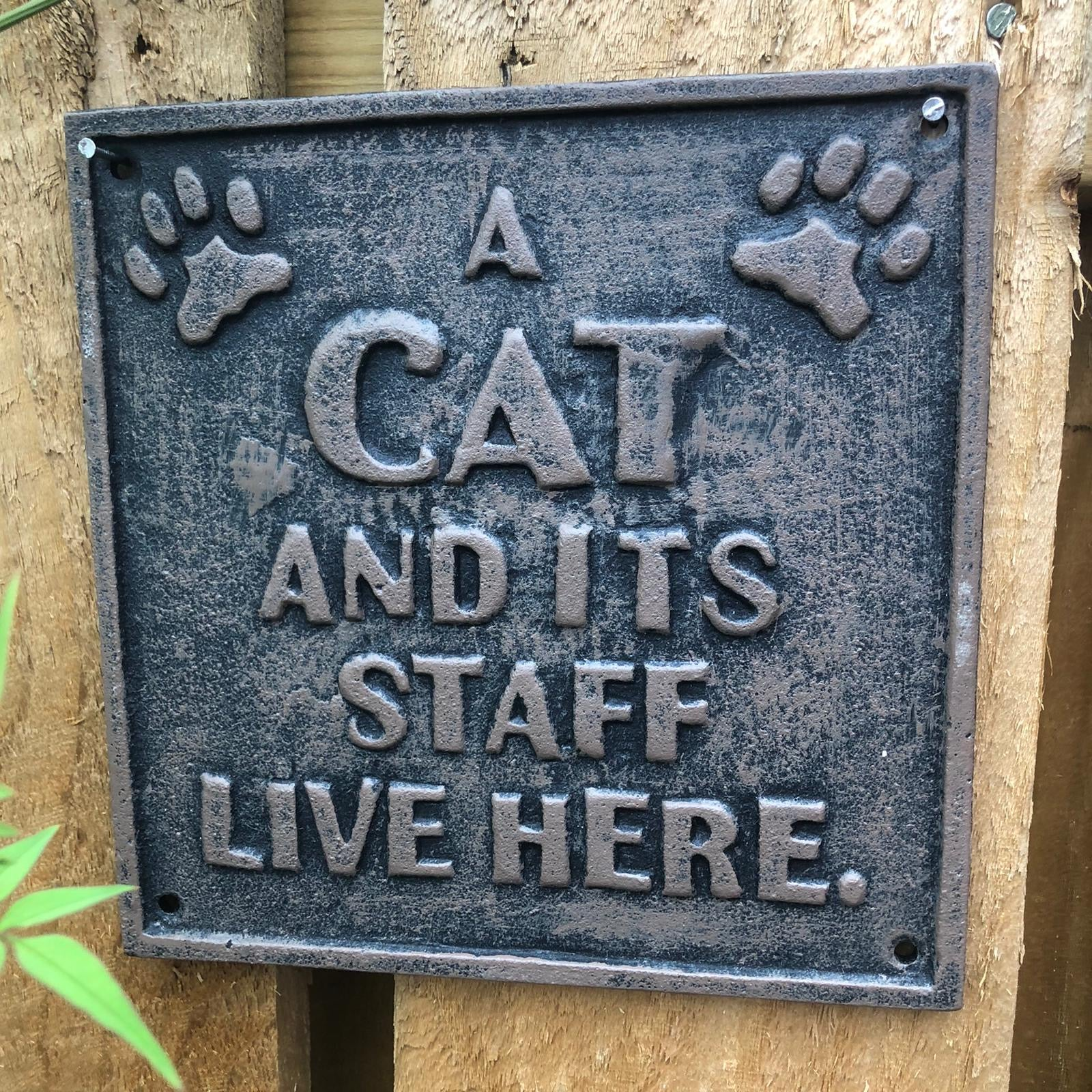 Metal Wall Plaque - A Cat And Its Staff Live Here
