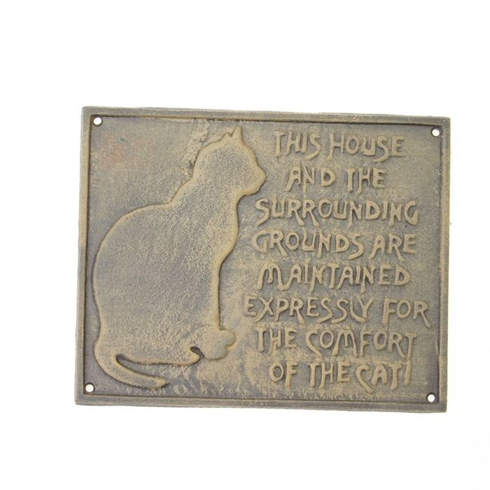 Metal wall plaque featuring cat plus humorous words