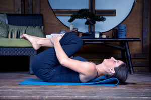 How to Do Knees-to-Chest Pose in Yoga