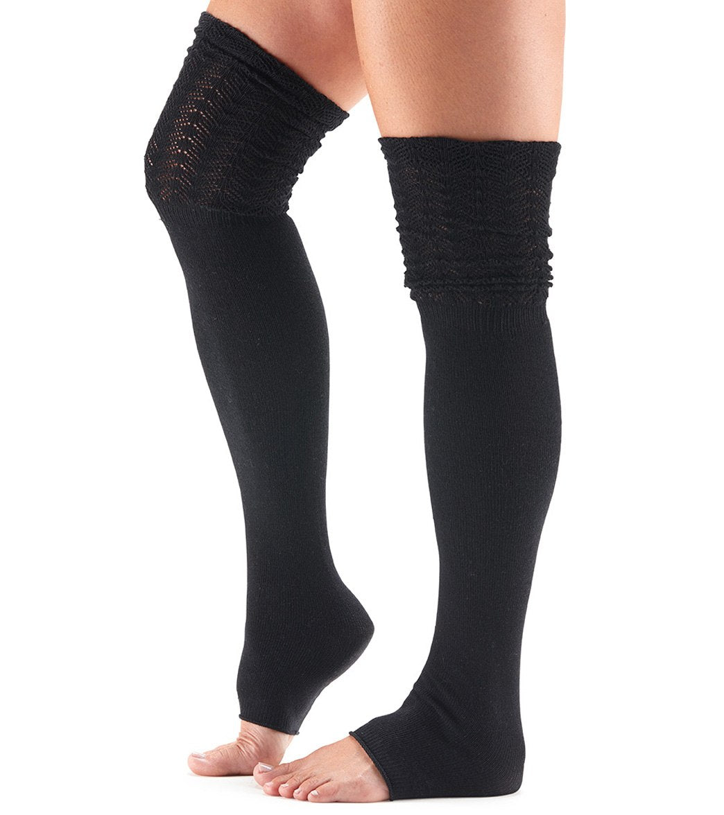 Whether you wear them thigh high or slouched over the knee, the Toesox Sasha Thigh High Socks are perfect for pilates, barre, dance and fashion-wear. Features Super soft ribbed knitting. Open toe style. Ultra flattering fanned welt. Can be worn thigh high or over the knee. Made from organic cotton and other materials. Details Fabric: 73% Organic Cotton, 20% Elastane, 5% Elastodiene, 2% Nylon Color: Vanilla, Beige Style Features: Textured, Open toe, Solid Grip: No Fit: Thigh high or under Arch Su