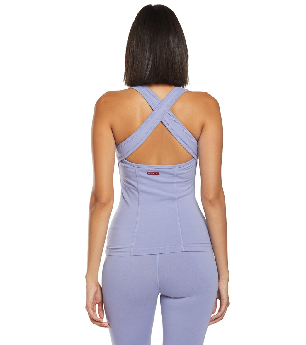 The Hard Tail Open Back Support Tank Tops is a necessity for your yoga wardrobe. The high neck gives you full coverage while the tank style and cross strap back keeps you cool and unrestricted of movement. Features High scoop neck. Solid colors. Built in shelf bra for added support. Sleeveless. Open cross back design, Fitted design that keeps tight to the body. Details Fabric: 90% Cotton, 10% Lycra Color: Black, Dove, Fig, Mauve, River, White Style Features: Solid, Open back cross strap design F