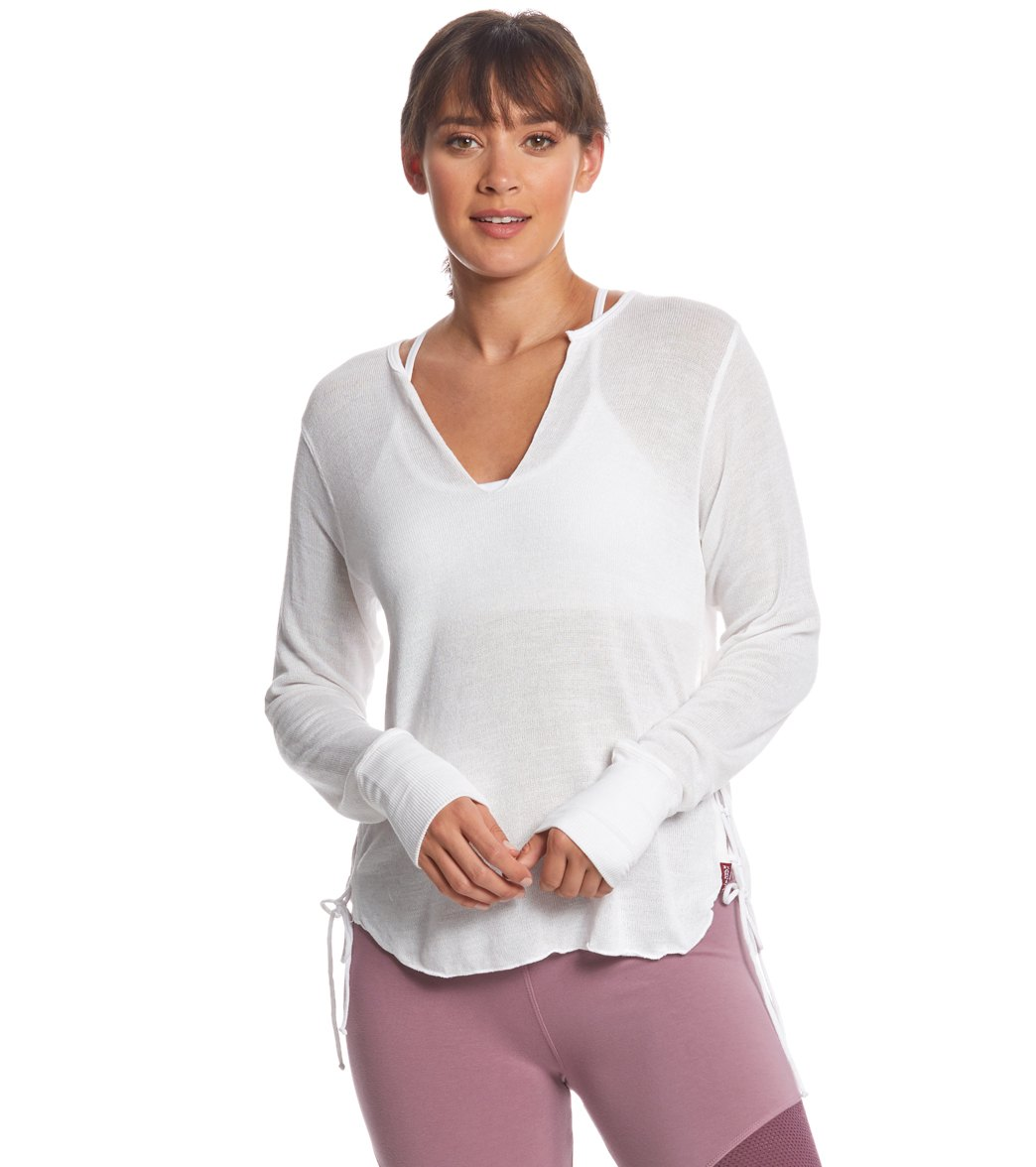 This Hard Tail Side Laced Pullover is perfect to throw on after yoga to meet up with friends or to finish your errands. Its soft sweater jersey fabric provides all-day comfort, while lace-up sides and an open front collar gives an on-trend look. Features Women\\\'s long sleeve pullover. Open front collar. Lace-up sides. High-low hemline with raw-edge hem. Ribbed cuffs. Details Fabric(s): 65% Rayon, 32% Polyester, 3% Spandex Color(s): White, Purple Style Features: Solid, Laced Fit: Relaxed Length: A