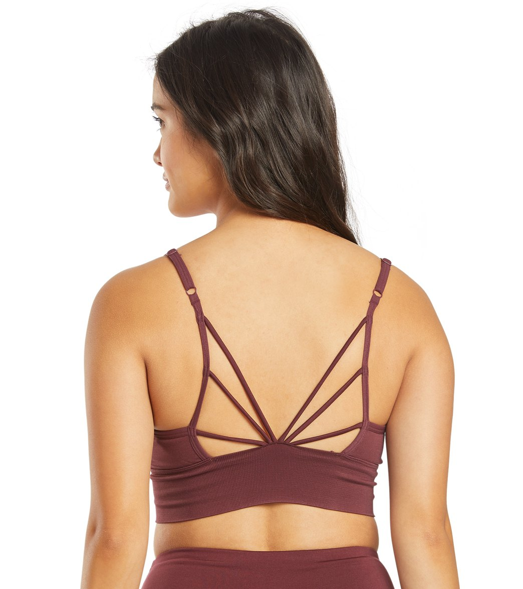 The seamless fabric of the Marika Jillian Seamless Yoga Sports Bra makes you feel comfortable throughout your workouts. FeaturesSeamless jacquard pattern Removable cups Low impact Adjustable back straps Dry Wik FinishDetailsFabric: Nylon/Spandex BlendColor: Black, Maroon, GreenStyle Features: Strappy backFit: TightCups: Removable cupsSupport: LowAdjustable: YesCountry of Origin: Imported About Marika: Founded in 1982, Marika is the flagship brand of Rock Fit, a family owned and operated company.