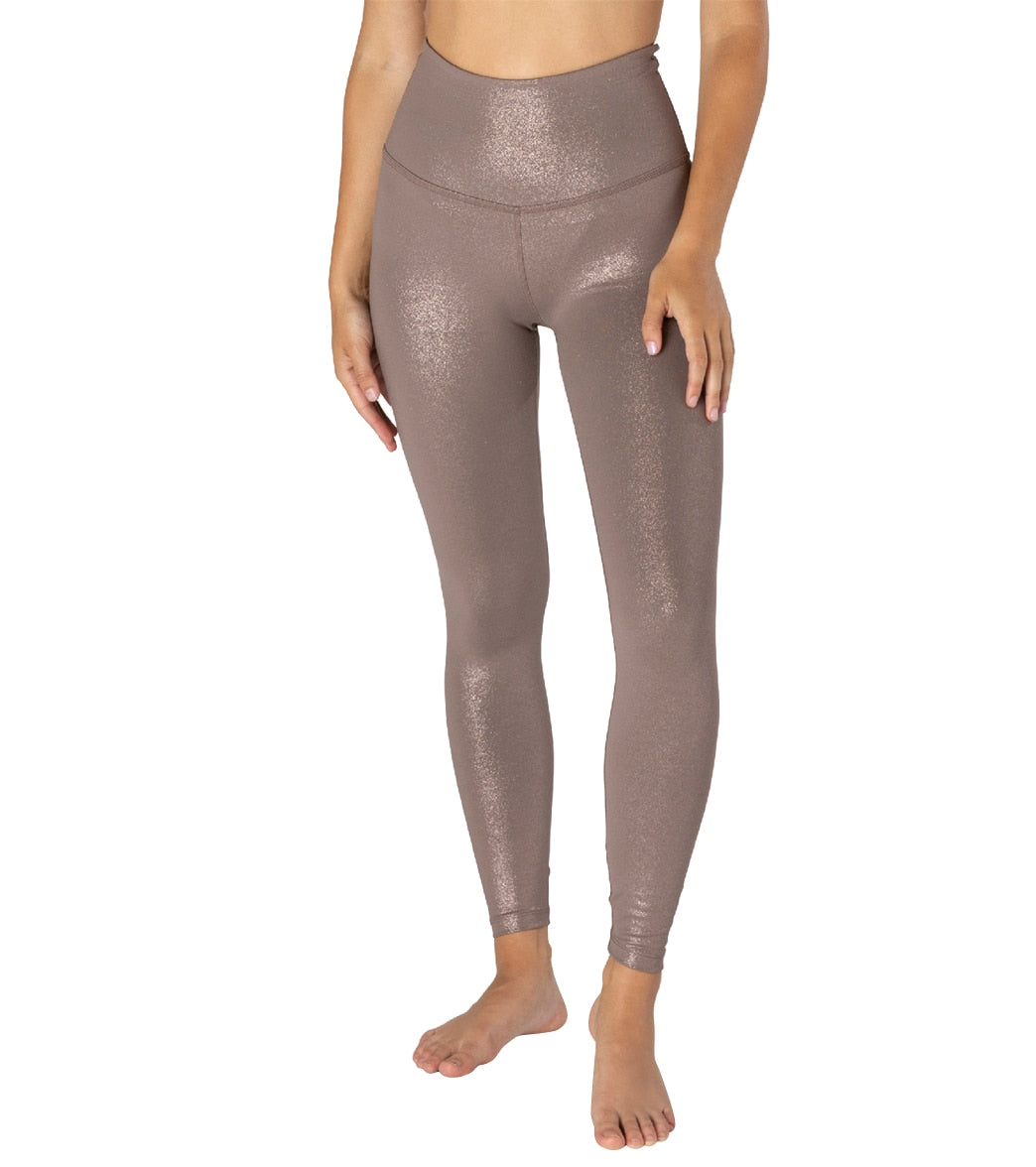 Make a statement at your next yoga session in the Beyond Yoga Twinkle High Waisted 7/8 Yoga Leggings. FeaturesTwinkle foil print No outside seams 5 waistband Midi length DetailsFabric: 82% Nylon, 18% SpandexColor: Black, PurpleStyle Features: Foil PrintFit: TightRise: HighAdjustable: NoLength: Above ankleCountry of Origin: Made in the USA. About Beyond Yoga: Beyond Yoga is a luxury lifestyle brand founded by Jodi Guber. The brand operates at the fulcrum of fashion and functionality, combining th