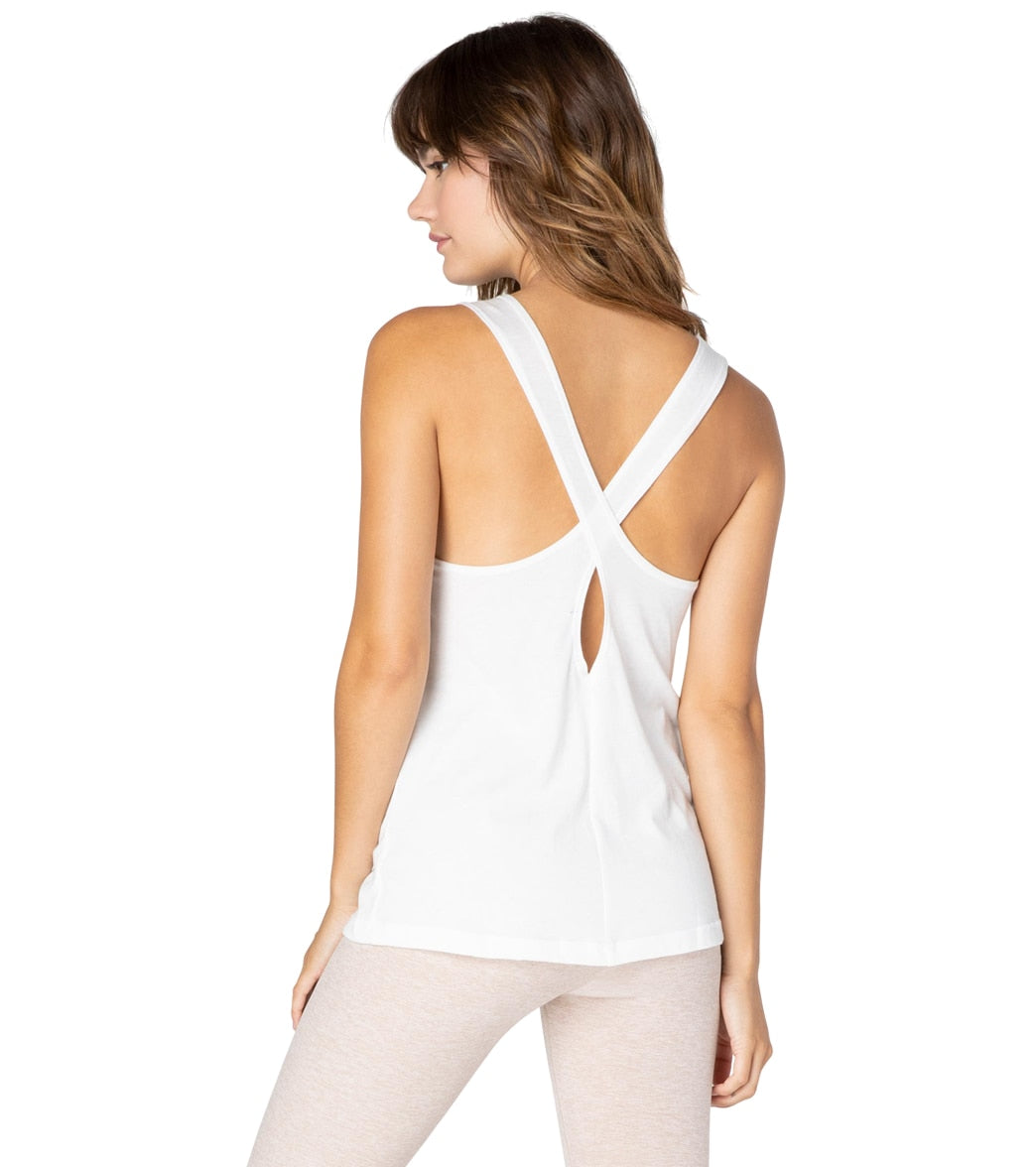 Who doesn\\\'t love a top that you can wear anywhere? The Beyond Yoga Boyfriend Jersey Crossback Yoga Tank can be worn to work out or for going out. You can also throw on a cute blazer if you want to get fancy. FeaturesYoga tank. Solid. Crossover back with keyhole. Relaxed fit. Low hip length. Lightweight. Locally sourced. DetailsFabric: 50% Cotton, 50% Polyester. Color: White or Latte Heather. Style Features: Crossover back with keyhole. Fit: Relaxed. Adjustable: No. Length: Low hip. Care: Machine