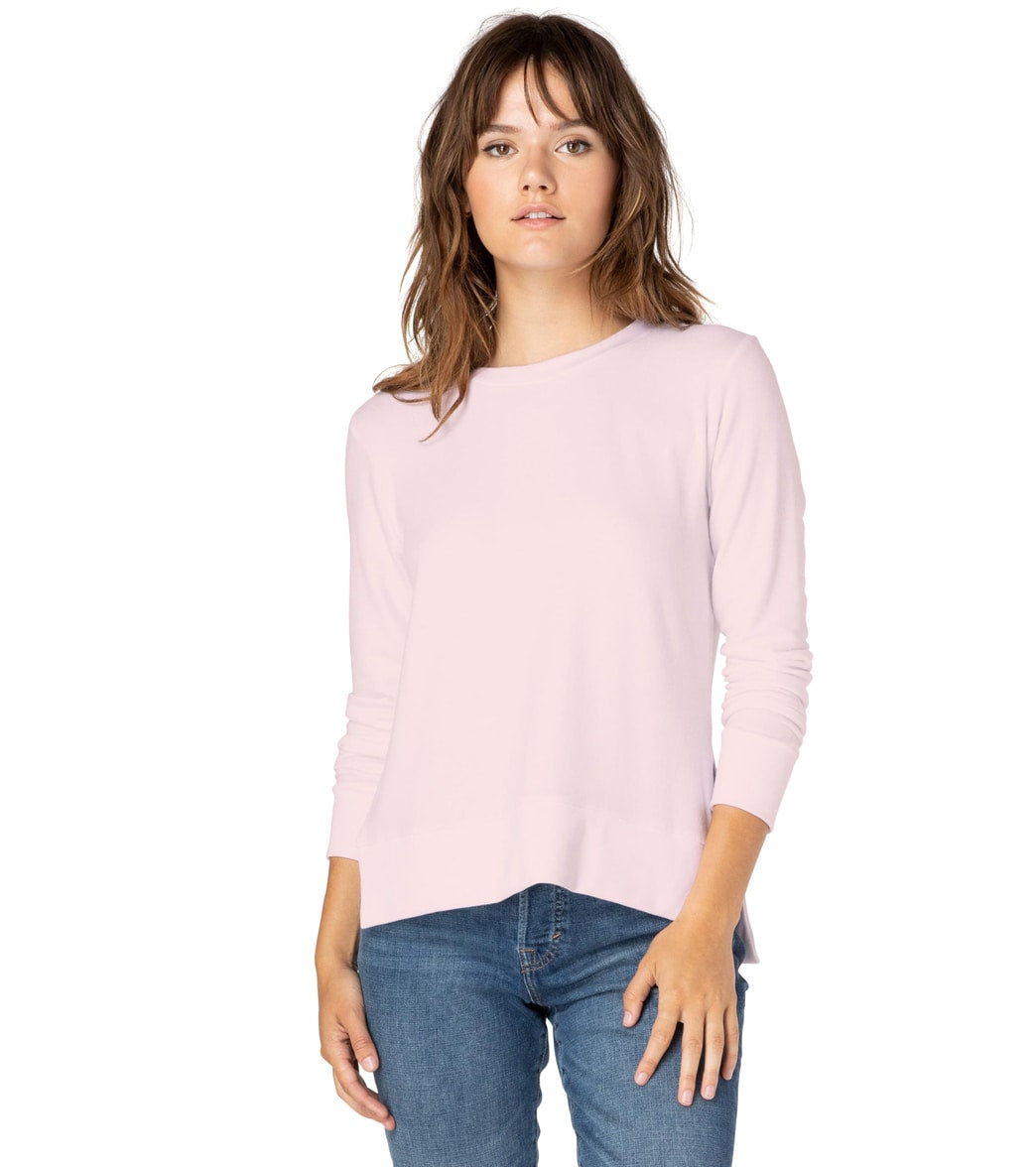 Feel cozy and look effortlessly chic in the Beyond Yoga Just Chillin Long Sleeve Pullover. FeaturesLong sleeve pullover. Solid. High low hem. Side slits. Relaxed fit. Low hip length. Ultra soft. Locally sourced. DetailsFabric: 47% Polyester, 47% Rayon, 6% Spandex. Color: White or Pink Blush. Style Features: High low hem, side slits. Fit: Relaxed. Adjustable: No. Length: Low hip length. Care: Machine washable. Country of Origin: Made in the U.S.A. About Beyond Yoga: Beyond Yoga is a luxury lifest