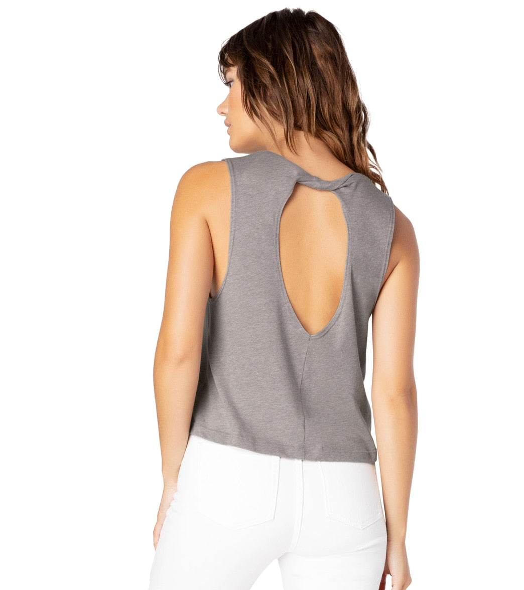 Look back at it in the Beyond Yoga Boyfriend Jersey Aquarius Yoga Tank. This tank features a trendy, twisted back detail. FeaturesYoga tank. Solid. Twisted back detail. Relaxed fit. High hip length. Lightweight. Locally sourced. DetailsFabric: 50% Cotton, 50% Polyester. Color: Aqua Mint Heather, White or Latte Heather. Style Features: Twisted back. Fit: Relaxed. Adjustable: No. Length: High hip. Care: Machine washable. Country of Origin: Made in the U.S.A. About Beyond Yoga: Beyond Yoga is a lux
