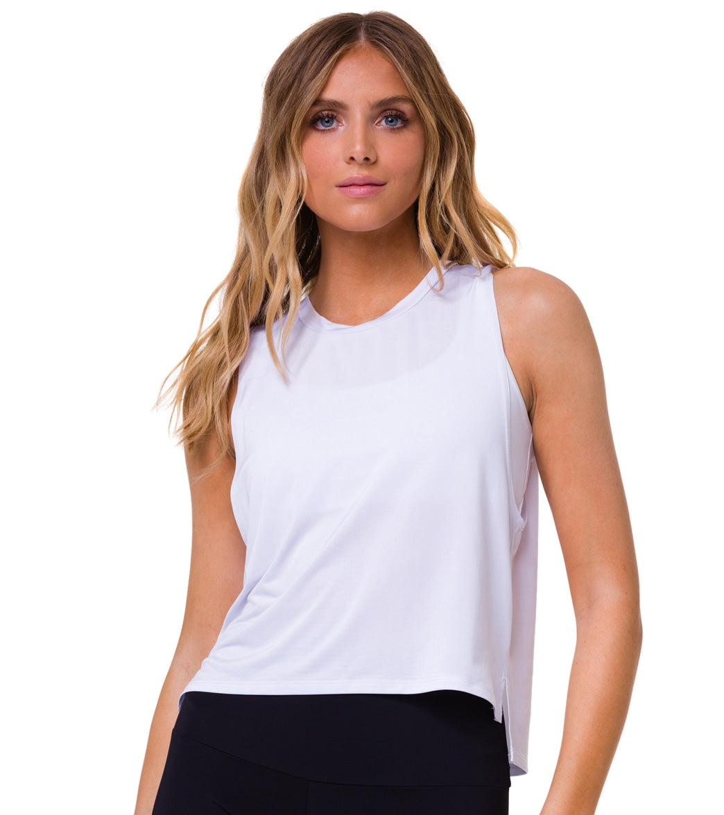 Work out your way in the Onzie Tempo Yoga Tank, which offers an easy cropped, muscle-tee silhouette plus quick-drying, moisture-wicking properties to keep you cool. FeaturesYoga crop top Super soft and comfortable fabric Round neckline Thick straps Side slits Slightly longer hem Moisture wicking Quick dryingDetailsFabric: 92% Polyester, 8% SpandexColor: Black, RedStyle Features: SolidFit: RelaxedShelf Bra: NoSupport: NoneAdjustable: NoLength: CropClosure: Pull onCountry of Origin: Made in the US