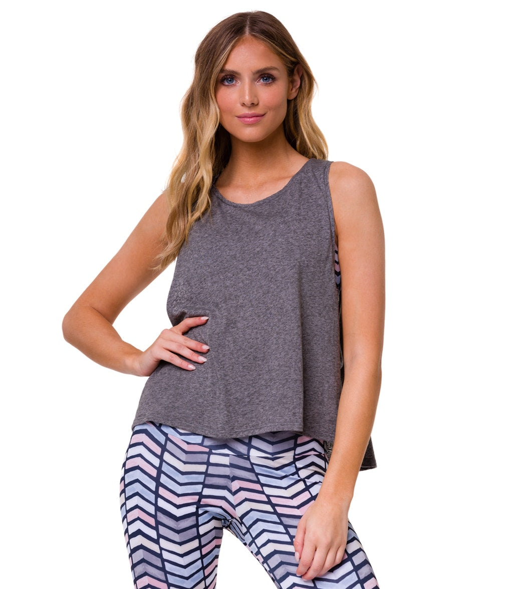 The Onzie Vintage Yoga Tank combines comfort, style, and functionality all-in-one. FeaturesLayering tank. Scoop neck. Dropped armhole. High-low hem. DetailsFabric: 75% Polyester / 25% CottonFit: RelaxedCountry of Origin: Made in U.S. A of imported materials About Onzie: Onzie was founded by a fearless woman and a devoted yogi with a Masters in Movement Therapy, Kimberly Swarth. She\\\'s the driving creative force behind Onzie and its collaborative company culture. Onzie blends the best of tradition