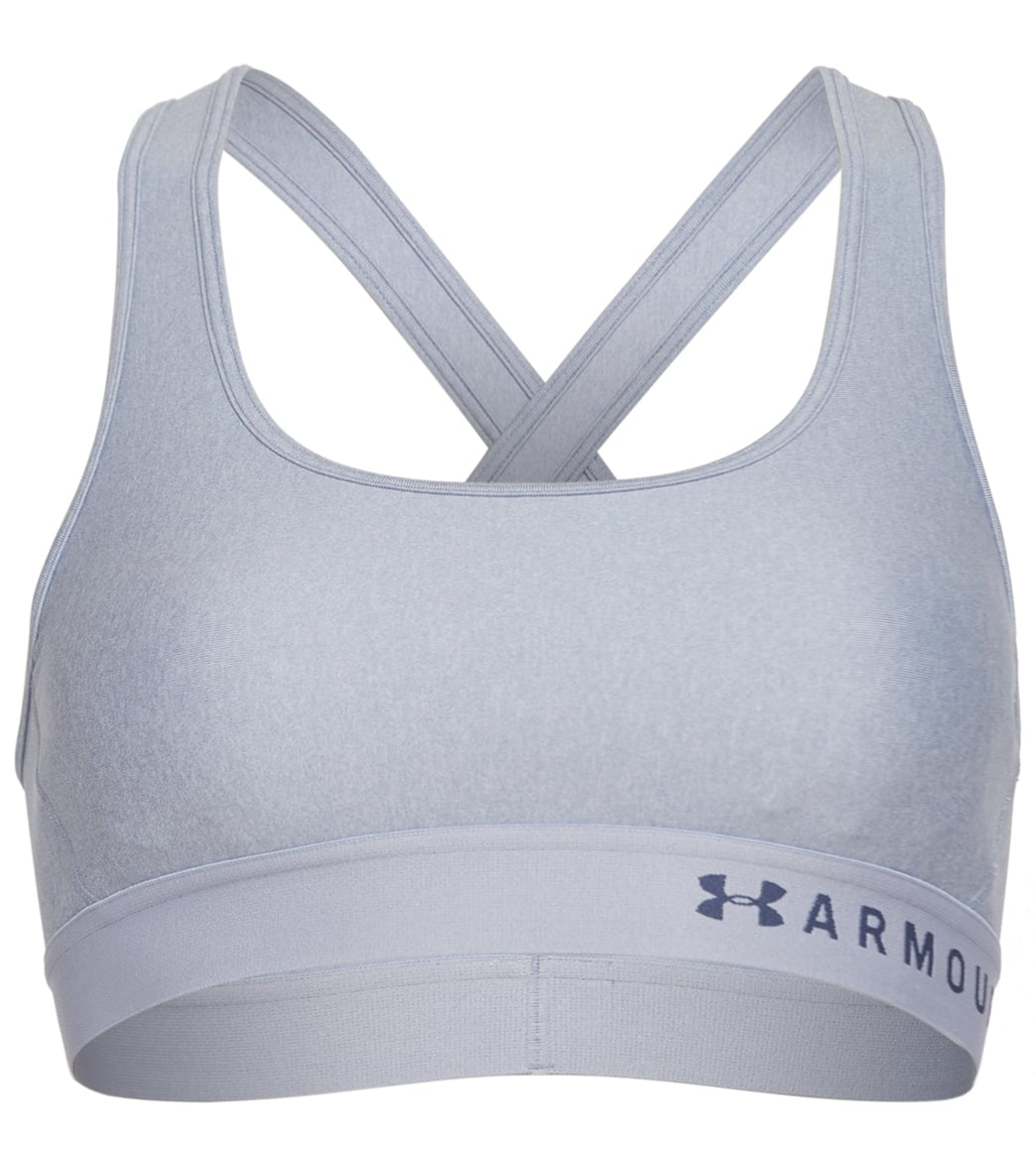 Get active in the Under Armour Women\\\'s Mid Crossback Heather Sports Bra. FeaturesSports bra. Solid with contrast elastic band featuring logo. Strategic support for medium impact. Soft, breathable cups. Removable cups. Crossover straps with keyhole detail. Updated elastic band. Super-smooth, double-layer HeatGear fabric. Material wicks swear & dries really fast. 4-way construction. Best for A to C cups. DetailsFabric: 87% Polyester, 13% Elastane. Care: Machine washable. Closure: Pull over. Back S