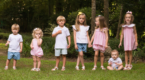 A group of children in Lullaby Set clothing