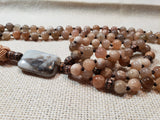 Hand Knotted Sunstone with a Banded Agate Guru Bead Mala