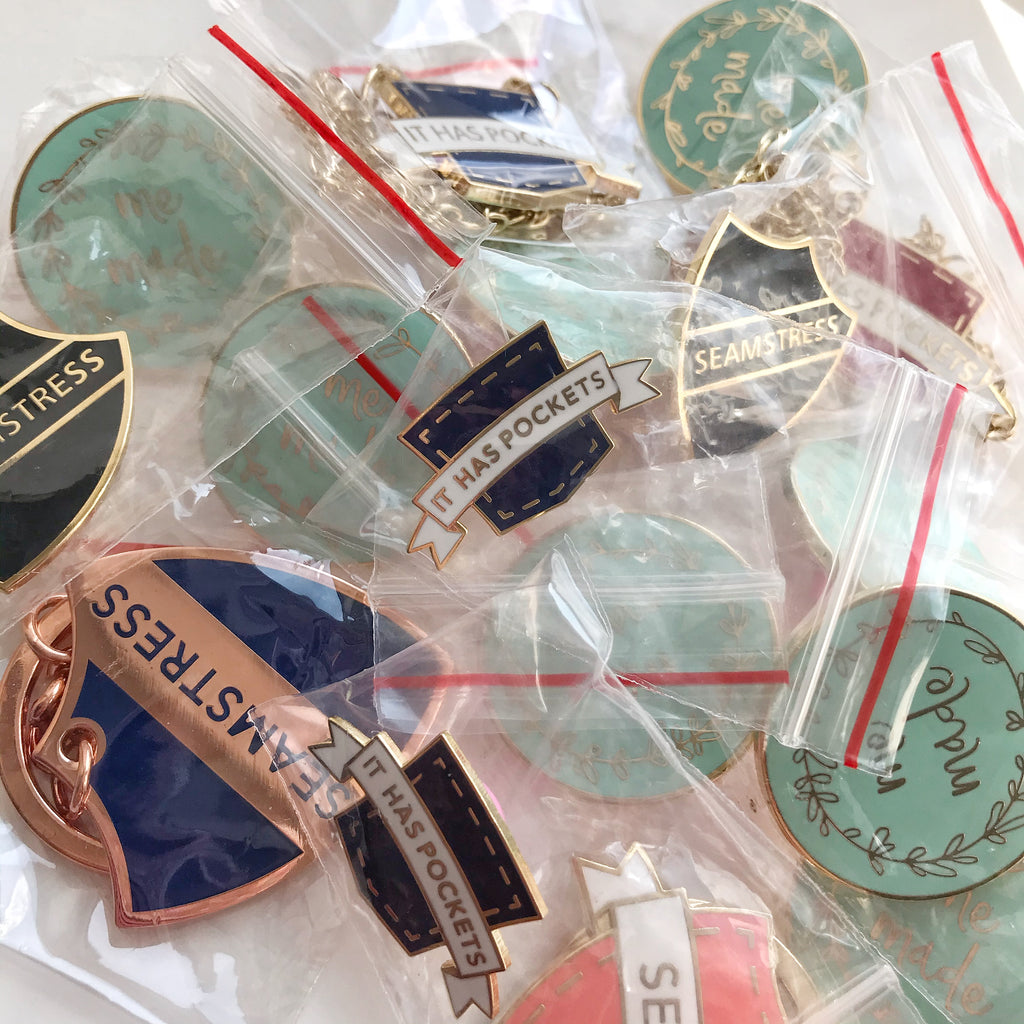 Seconds Sale: Pins, key chains & necklaces