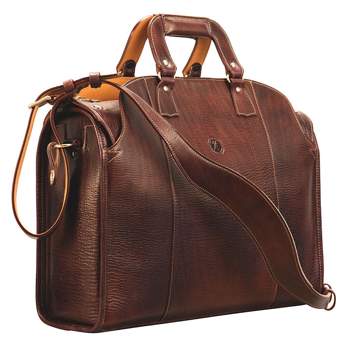 Glaser Designs Travelers' Briefcase. Hand colored Espresso vegetable tanned leather. Padded construction. Contoured shoulder strap. Reinforced handle. Solid brass and bronze hardware. Custom modular organization. Made to measure, custom size