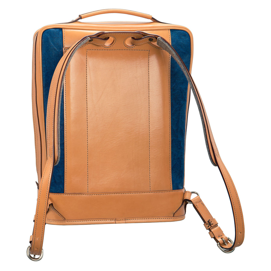 Glaser Designs Business Backpack. Hand burnished Natural vegetable tanned leather with Hand painted Blue linen. Solid brass hardware. Made to measure, custom size.