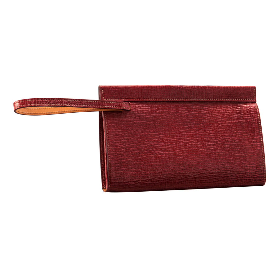 Glaser Designs Clutch Portfolio. Hand colored Barn Red vegetable tanned leather. Magnetic closure and retractable wrist strap. Made to-measure, custom sizes.