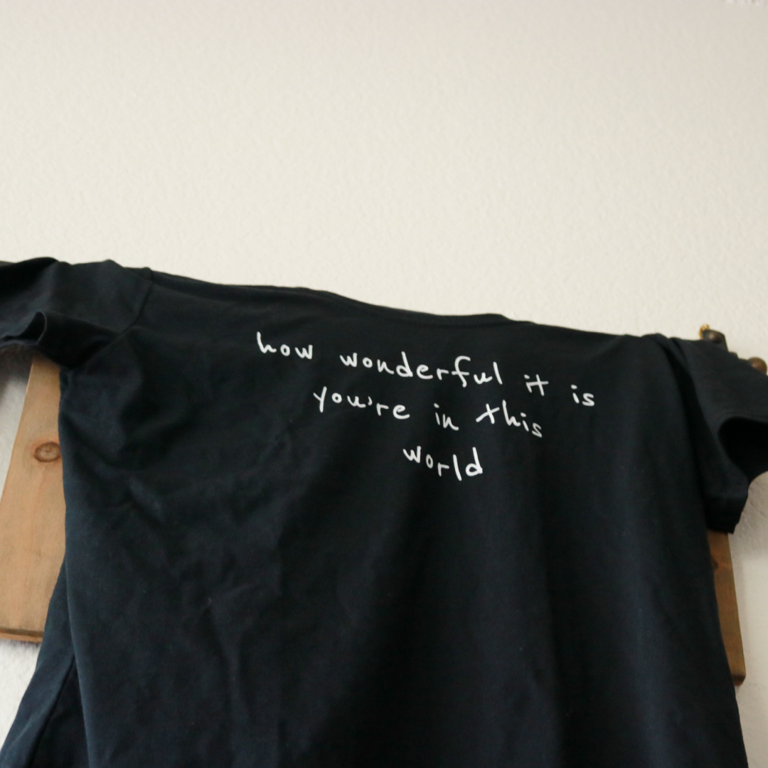 How wonderful it is you're in this world Tee