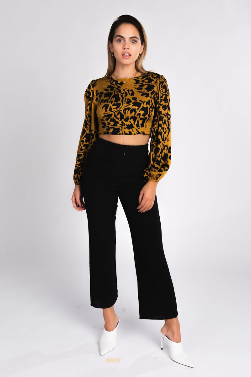 Cheetah print open back crop top, double tie back cheetah print top, animal print, fall fashion trends 2018, exaggerated sleeves, fall crop tops, wear with black high waisted trousers