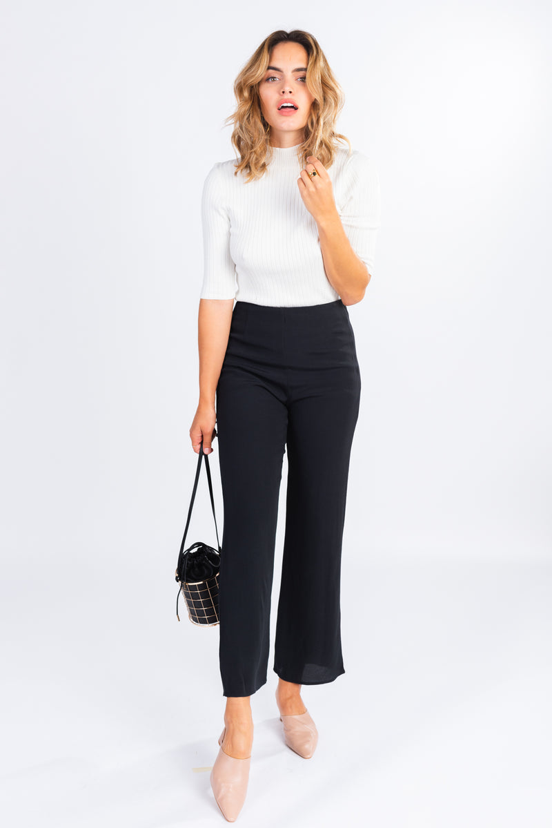 white mock neck cropped top, ribbed turtleneck sweater, 3/4 sleeve white sweater, black high waisted trousers, cropped trousers
