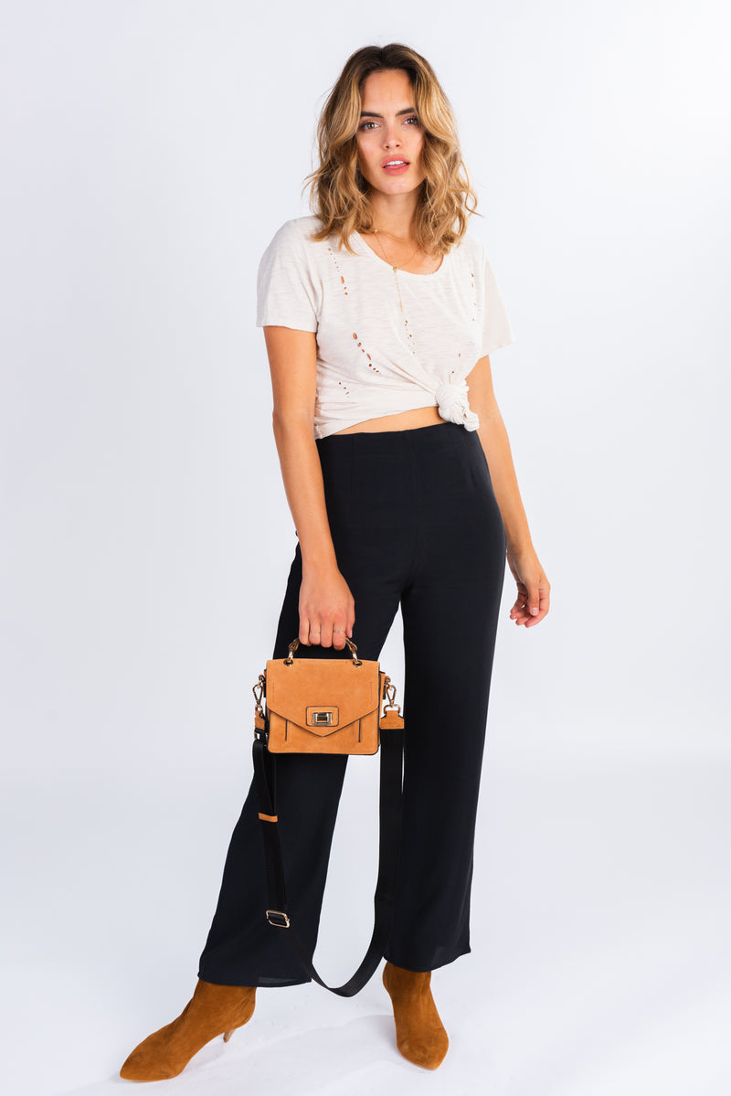 oversized distressed t-shirt, cream distressed tee, wardrobe basics, pair with the perfect high waisted trouser