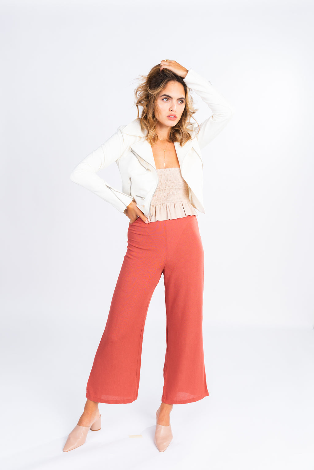 high waisted light rust trouser, flare cropped trouser, modern basics, pair with white moto jacket and crop top