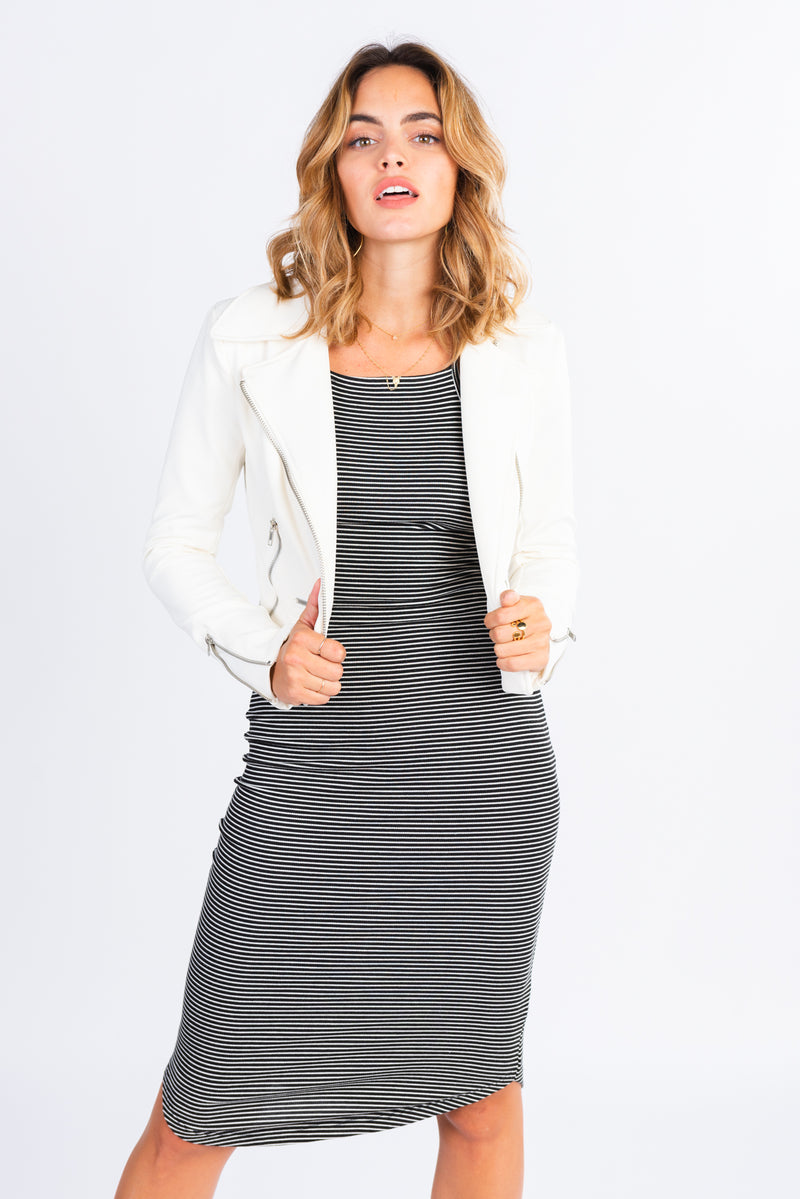 striped midi dress, black and white striped racerback body con dress, fitted midi dress, paired with cropped white moto jacket