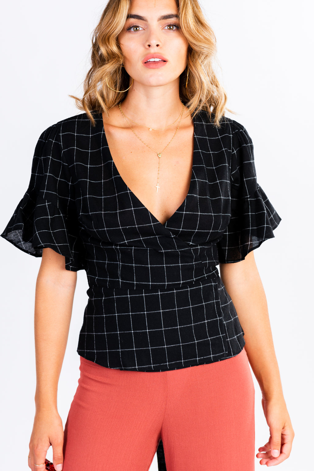 gridline stripe wrap top, black and white wrap blouse with statement sleeves, ruffle sleeve, checked blouse, modern wardrobe basics, wear to work