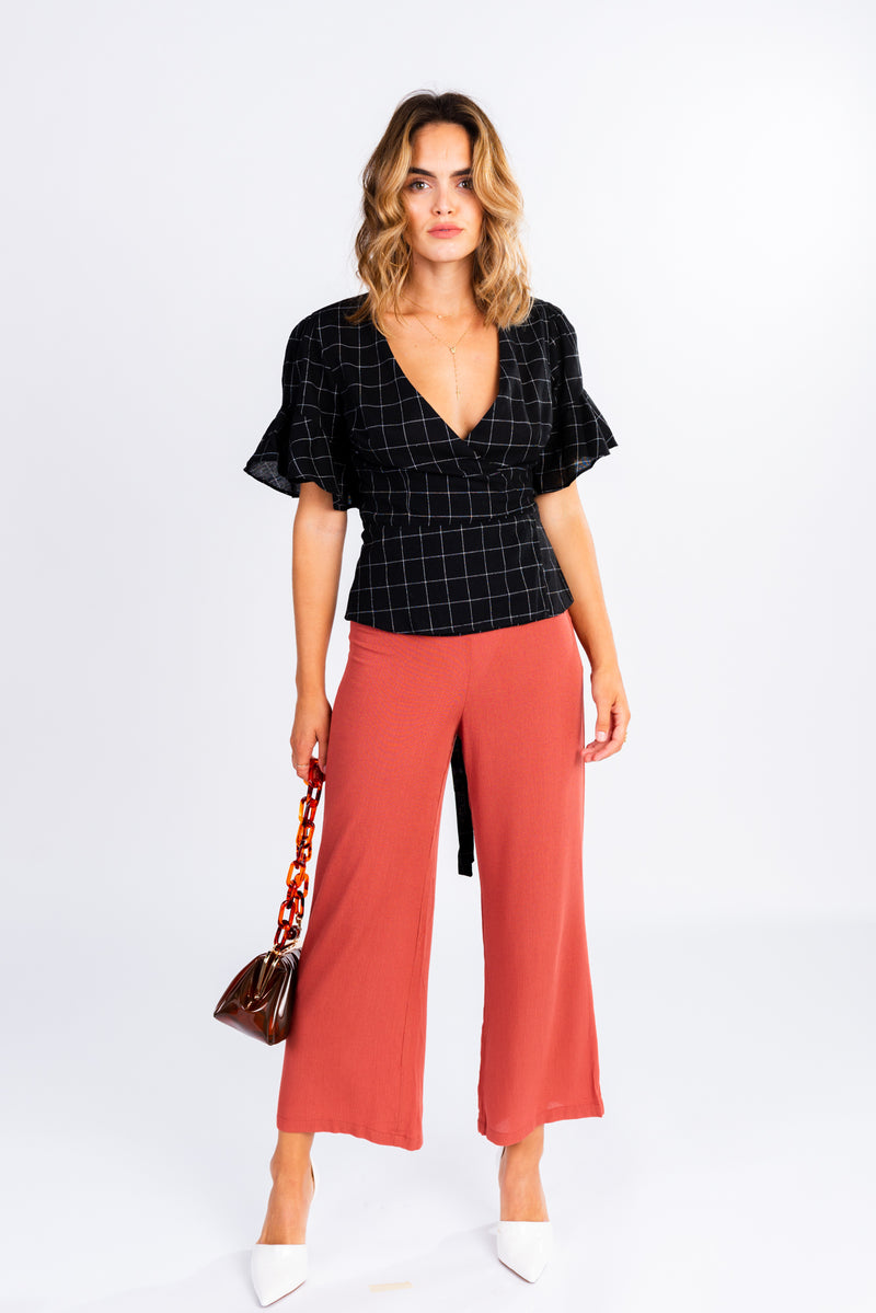 gridline stripe wrap top, black and white wrap blouse with statement sleeves, ruffle sleeve, checked blouse, modern wardrobe basics, wear to work, coral high waisted trousers, white pointed toe mules