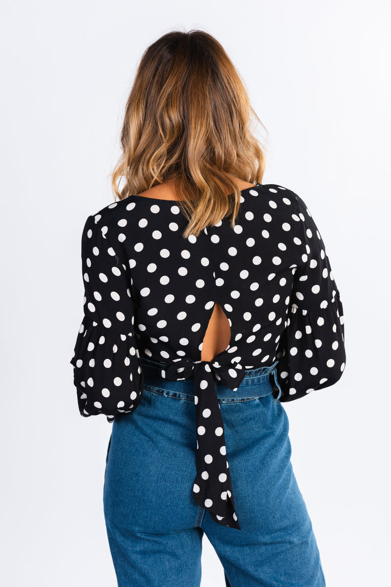 polka dot crop top, long sleeve black and white polka dot tie back blouse, exaggerated sleeve crop top, high neck blouse