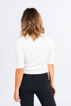white mock neck cropped top, ribbed turtleneck sweater, 3/4 sleeve white sweater, black high waisted trousers